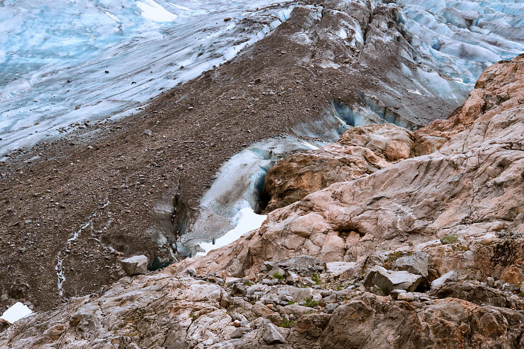 Blue compressed ice with dirt and rocks on, at the foot of the Folgefonna glacier in Norway